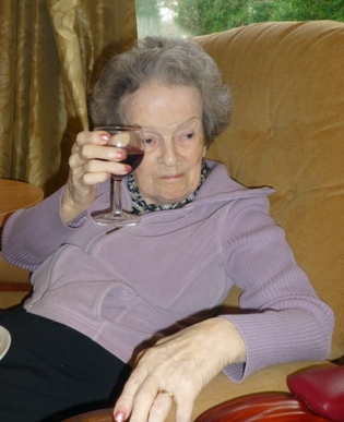 Celebrating her 90th with a glass of wine